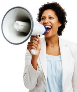 Business woman screaming on a megaphone over white