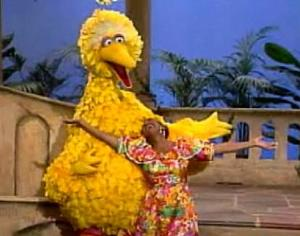 """Queen of Salsa"" Celia Cruz (shown here with Big Bird) is among the many petite women who've left a big mark on global culture, politics, and business."